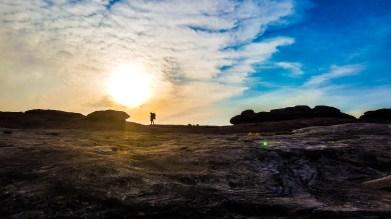 Sun setting behind Eric at Canyonlands National Park