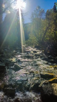 Crossing Little Cottonwood Creek for a photo op