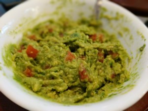 One fresh avocado mashed with one roma tomato, some chopped jalapeno and some garlic salt make a fresh and tasty vegetarian lunch