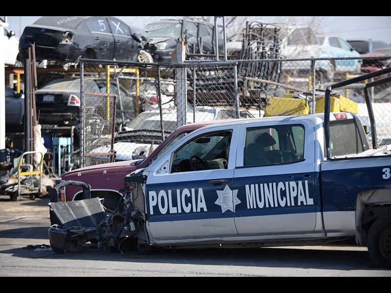 Una patrulla de la Secretaría de Seguridad Pública de Juárez en un yonke local