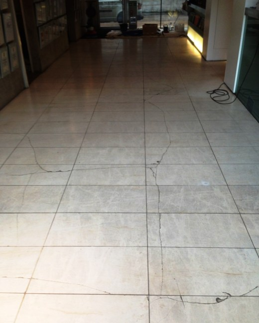 Damaged Limestone Tiled Floor in Wilmslow Before