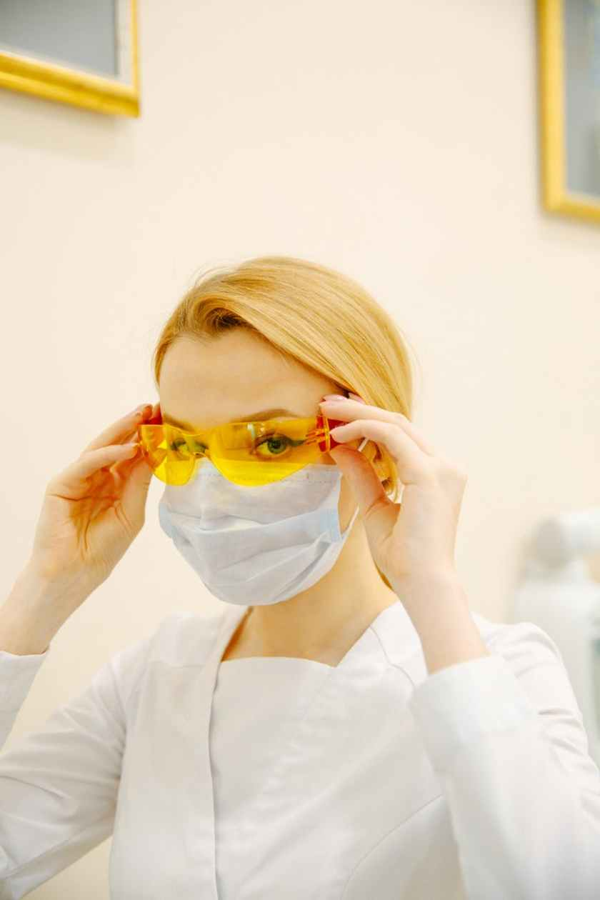 woman in white long sleeve shirt wearing yellow goggles