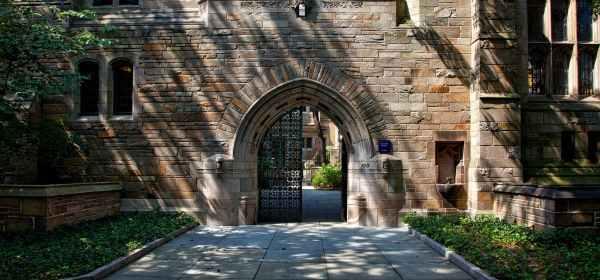 steel gate of brown brick building