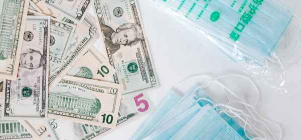 set of american cash money and medical facial masks