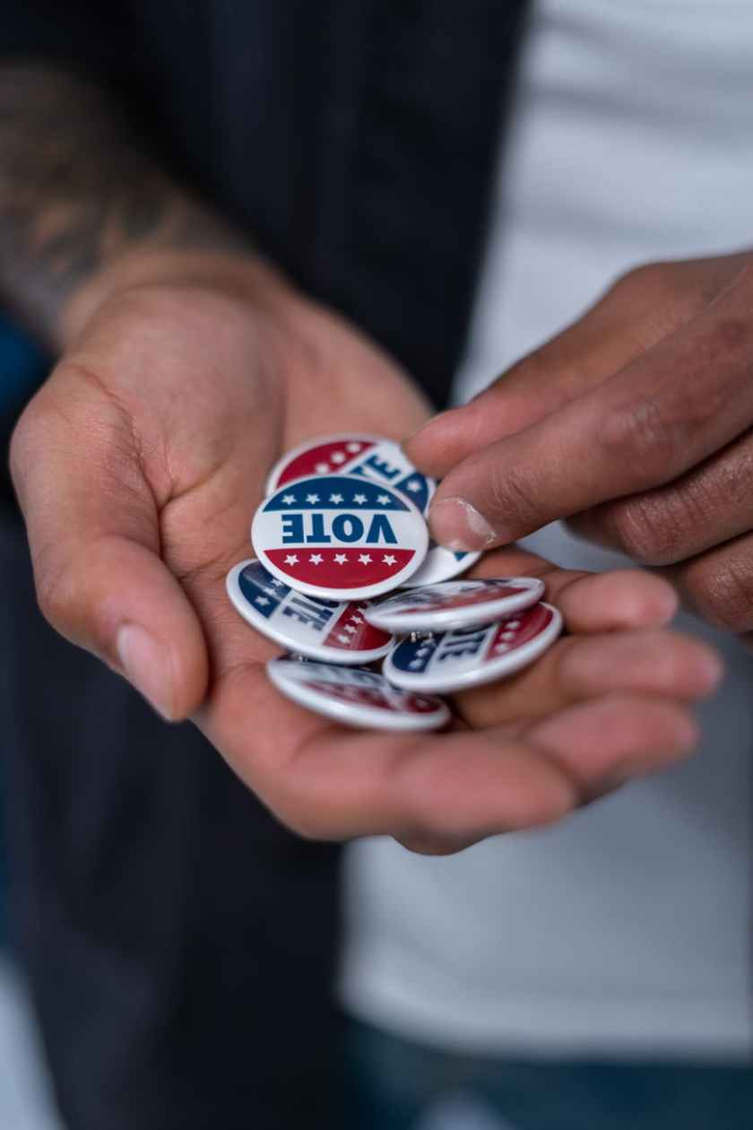 hands with vote pins