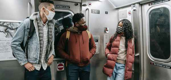 diverse passengers speaking while travelling on subway