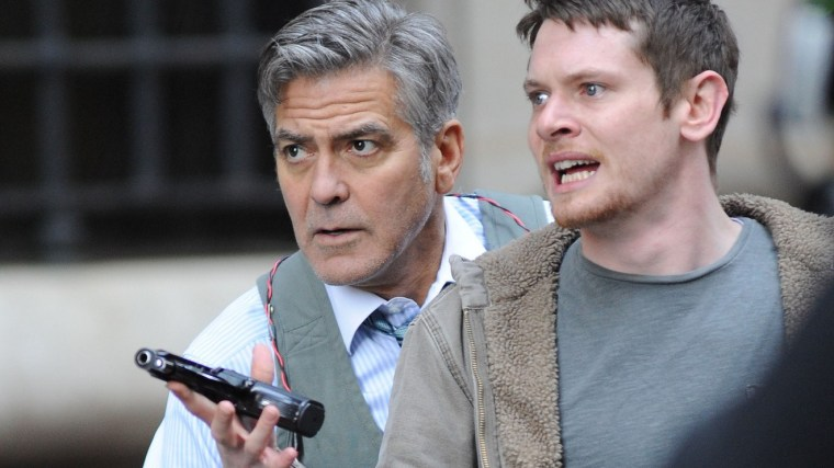 Lee Gates (Clooney) and Kyle Budwell (Jack O'Connell)  Kyle is labelled as a terrorist but see his motivations and reasoning, subsequently feeling bad for the guy.  (Money Monster, Sony Pictures Entertainment)