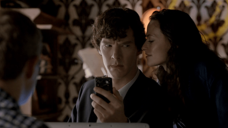 Sherlock (Benedict Cumberbatch) looking uncomfortable with Irene Adler (Lara Pulver)  (Sherlock, BBC One)
