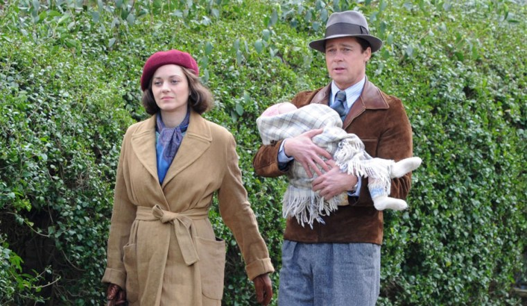 Brad Pitt and Marion Cotillard living up the 40s attire in Allied (Allied, Paramount Pictures)