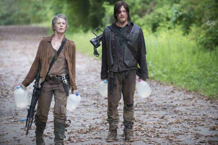 Two of the show's badasses, Daryl Dixon (Norman Reedus) and Carol Peletier (Melissa McBride)  (The Walking Dead, AMC)