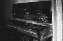 A Wellington upright piano in need of minor tuning. Old Main, Northampton State Hospital