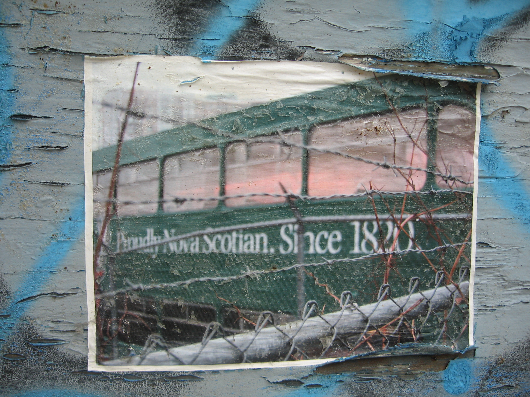 Photocopy of a double-decker tour bus plastered on a garage door on Harris Street.