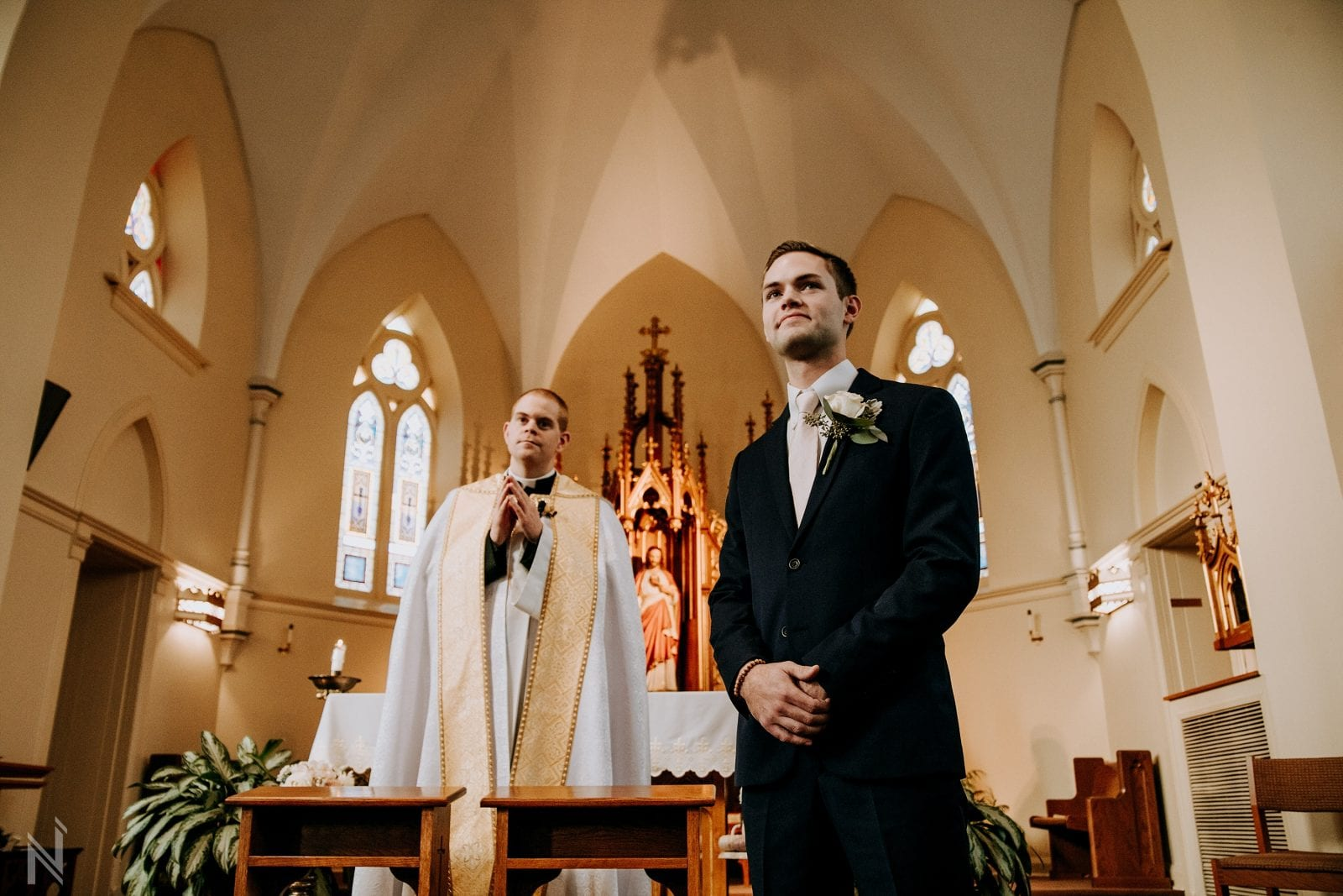 wedding photography at immaculate conception catholic church in OFallon, Missouri
