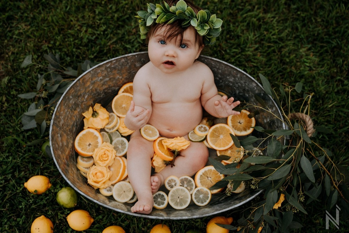 Styled lemon citrus outdoor rustic milk bath baby photography in St. Louis
