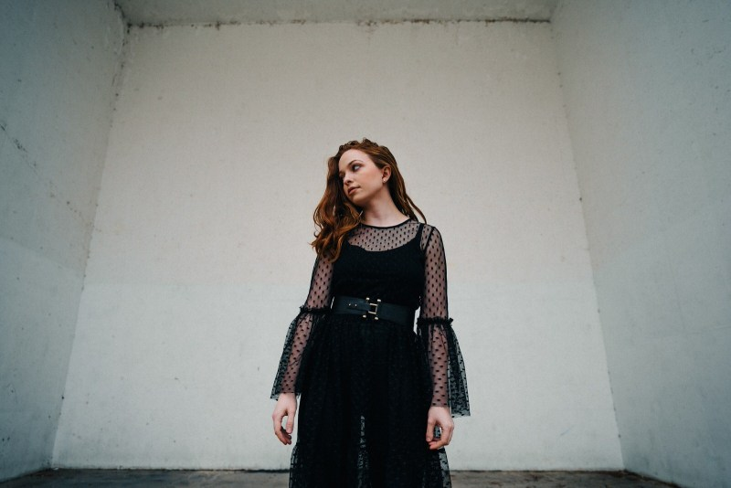 moody winter fashion and conceptual photography in a racketball court in st. louis