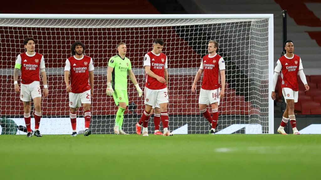 The Arsenal defence dejected after conceding in the last minute
