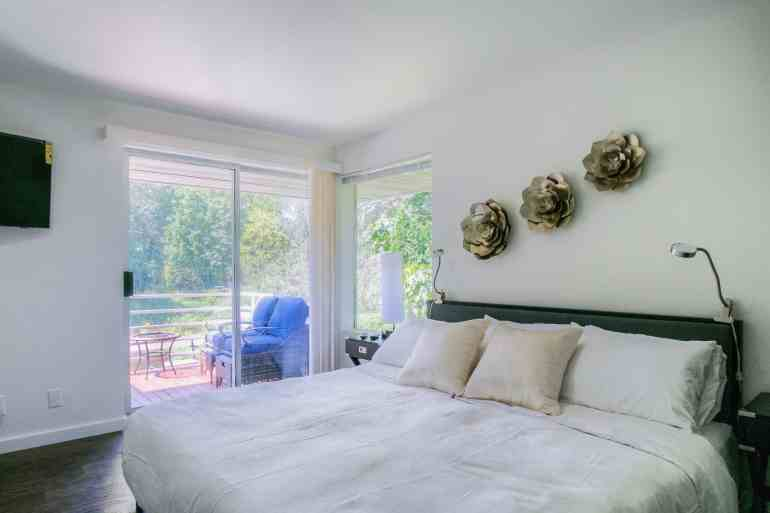 Suite 5 Master Bedroom with Balcony overlooking River and Park