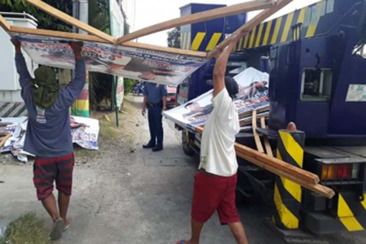 Comelec in Pangasinan removes illegal campaign ads