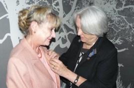 Past-President-Janet-Callard-(right)-pinning-the-president-lapel-to-President-Ann-Coral-Stewart-(left)