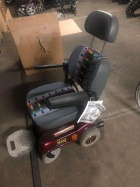 The electric wheelchair that is going to be life changing for its proposed beneficiary. Some adjustments needed and he will be good to go.