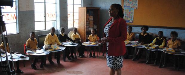 Teacher-in-the-classroom-Tutu-Desk-campaign