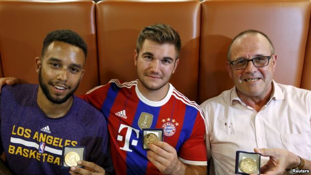 Americans Anthony Sadler and Alek Skarletos, and Briton Chris Norman (L-R) pose with medals they received for their bravery at a restaurant in Arras, France, Aug. 21, 2015. Not pictured is American Spencer Stone.