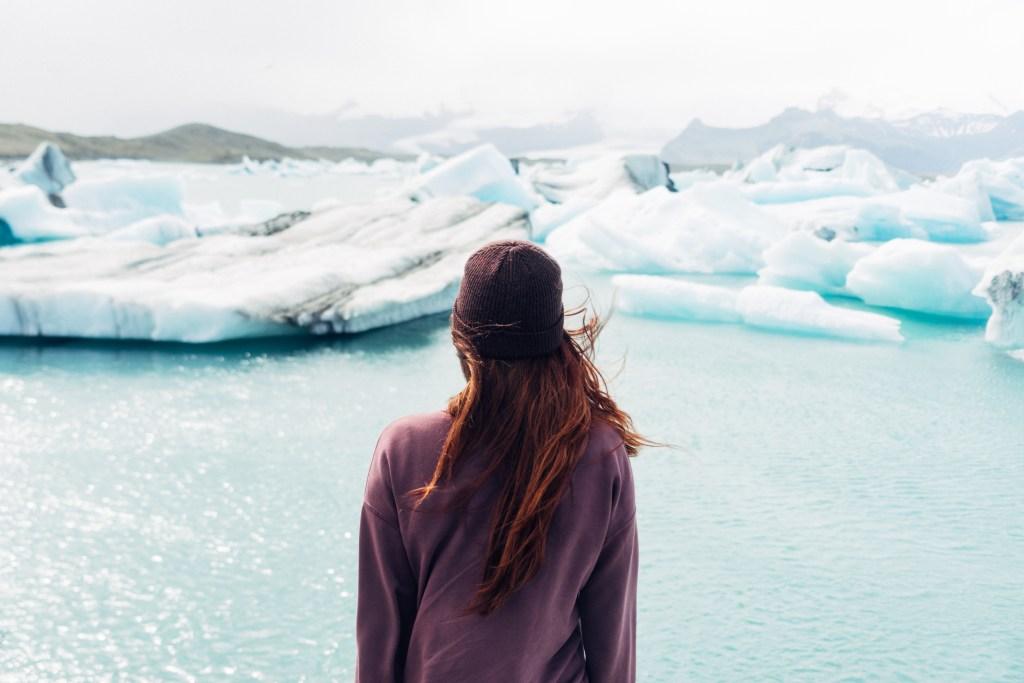 Woman looking at ice sheet