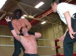 """""""The Monster"""" Cenobite chokes out Rob Impact during their Non Sanctioned Match in the night's Main Event."""