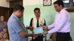 Assam: DC, Hailakandi felicitates Yash Sarda, 8th rank holder of HS exam