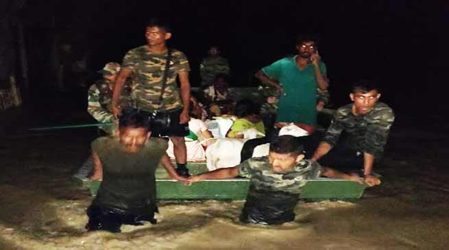 Assam:Flood relief operation by the Army in Sibsagar
