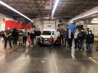 Maria Roca, administrators, teachers, students, and representatives from Second Chance Cars, the Massachusetts National Guard, Metro Credit Union gathered on Tuesday as Roca received a car from Second Chance, repaired by Northeast Metro Tech. (Courtesy Photo)