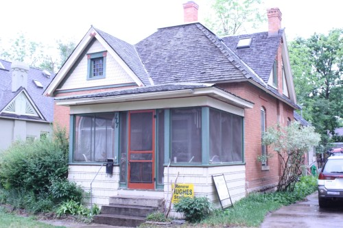 This Queen Anne residence at 117 S. Whitcomb is one of a set of four brick houses along the west side of the street. Similar Queen Anne style wood frame houses were built directly across the street making a matched set of 8 houses. Of these, 7 remain and, along with other historic houses on the street, form the Whitcomb Street Historic District which was formed in 2012.
