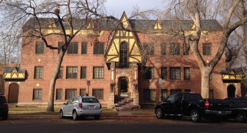 The steep gable over the doorway, heavy stone around the door, and other decorative features make this apartment building really stand out along Mathews street. I'm a little confused, however, by this photo in the Larimer County Water Ways collection which appears to show this same building with an Art Deco construction.