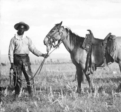 Unidentified Black cowboy with horse (Photo from the Denver Public Library Digital Collection.)