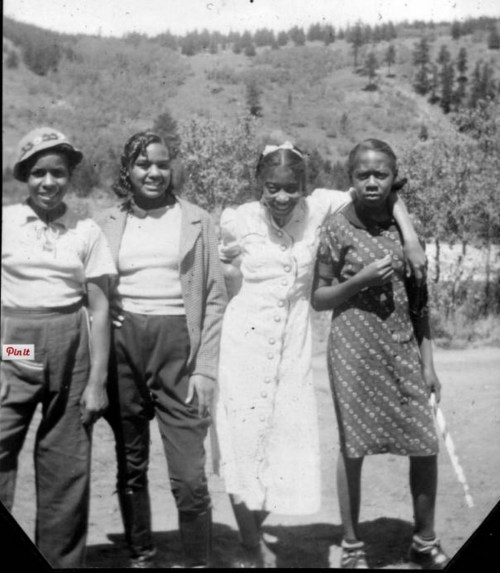 Four campers pose together on the grounds of Camp Nizhoni in Lincoln Hills (Gilpin County), Colorado. (Photo from the Denver Public Library Historic Archive.)