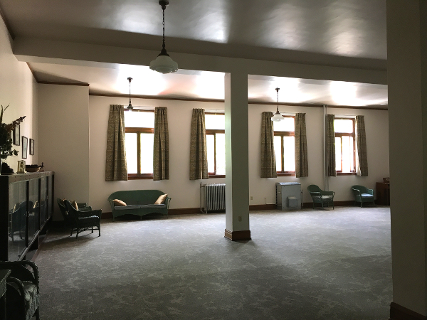 A part of the carpeted meeting room that used to be the library.