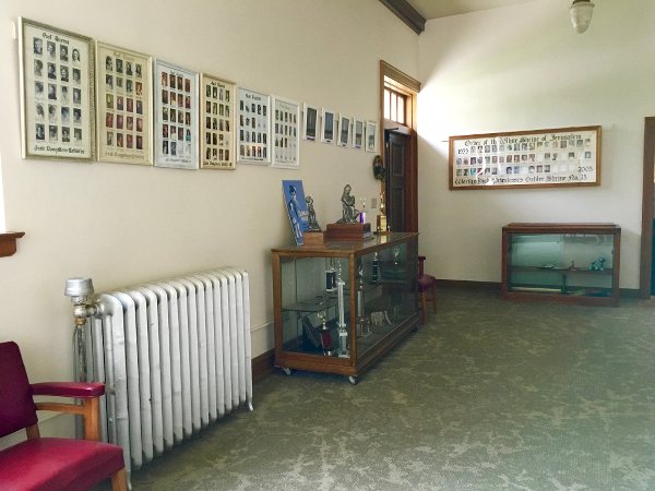 Note the old radiator and all the photos in the vestibule area.