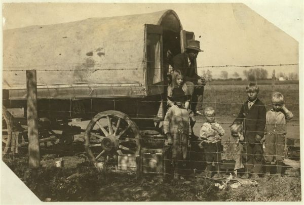 "The caption on this photo from the Library of Congress reads: ""The prairie-wagon home of a family of itinerant beet workers, now camped near Ft. Collins, Colo. Street family. The children 7- 8- 10- and 12 work steadily and I saw the tiny girl pulling beets after sunset on the following Sunday, and they had not yet finished. The father told me ""We got squeezed out of the mountains,"" one of the neighbors said they has been chased out because they wouldn't send their children to school. Living on the edge of Ft. Collins, they boldly work the children and violate school law. Came from Log Cabin, Colo. Location: Fort Collins [vicinity], Colorado / Photo by Hine, Oct. 30/15."" (Control #: ncl2004004413/PP)"