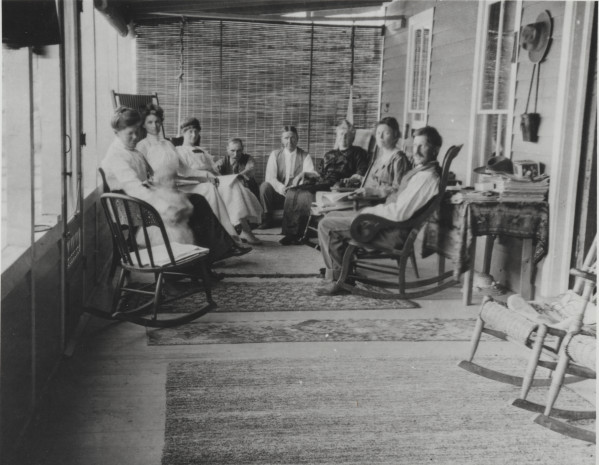 This Fort Collins Archive photo (H10788) was taken on the front porch at Pinehurst. From left to right are: Norman Fry's sister, Auntie Scott, Norman Fry's sister, Herman Mertens, Uncle Scott, Norman Fry's Mother, Maude Fry, and Norman Fry