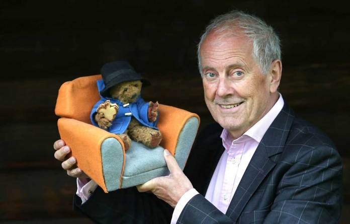 Gyles Brandreth with the original Paddington Bear