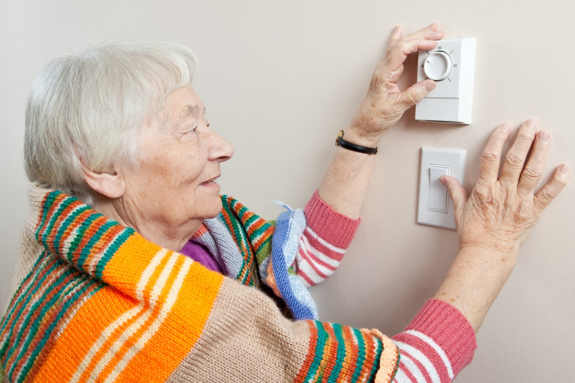 happy old lady,joyful old lady,checking temperature, old lady