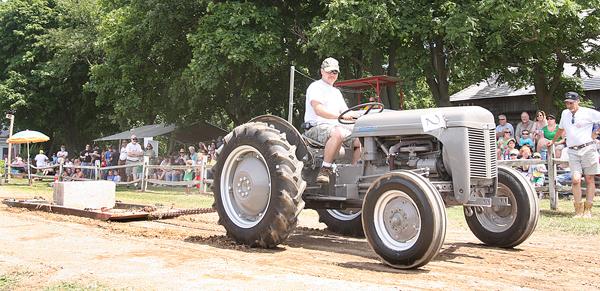 Photo by Barbaraellen Koch | Joe Pancini pulls 3,000 pounds on his 1953 Ferguson tractor.