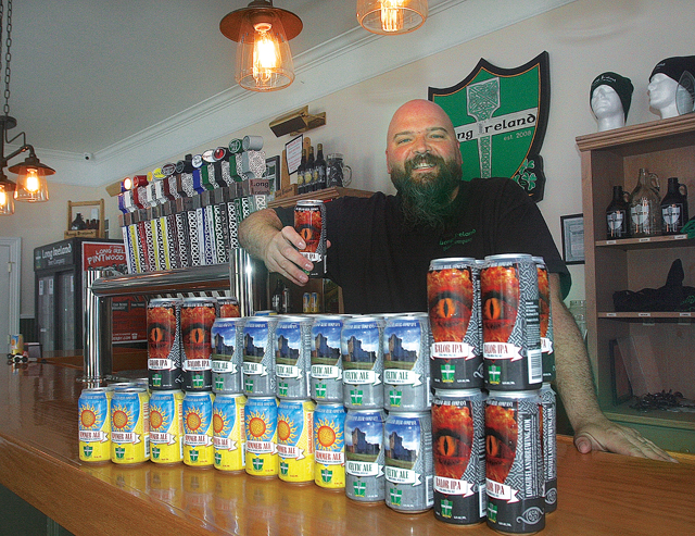 Dan Burke shows off Long Ireland's new cans. (Credit: Barbaraellen Koch)