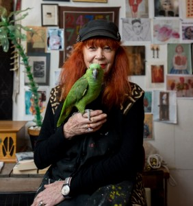 Garance poses with one of her parrots. (Credit: David Benthal)