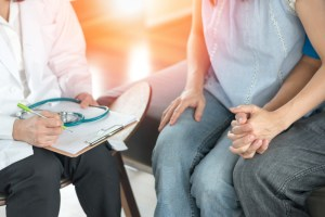 Couple speaking with doctor about infertility