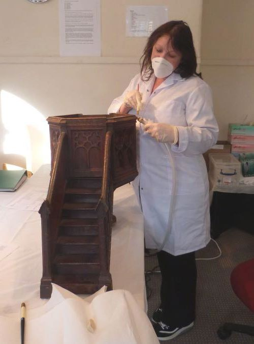 Gill cleaning a model pulpit
