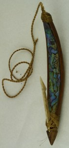 A mother-of-pearl, wood and bone hook