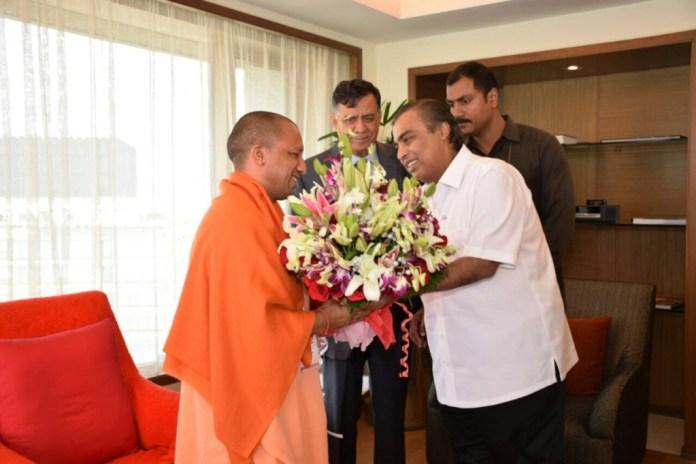 Industralist Mukesh Ambani Shaking hands with CM, Yogi
