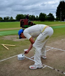 Painting the grid on the crease... MC is a dab hand with a brush!!