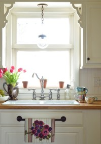 Flowers & teacups add colour - http://www.jenniferrizzo.com/search/label/ikea%20wood%20counter%20tops